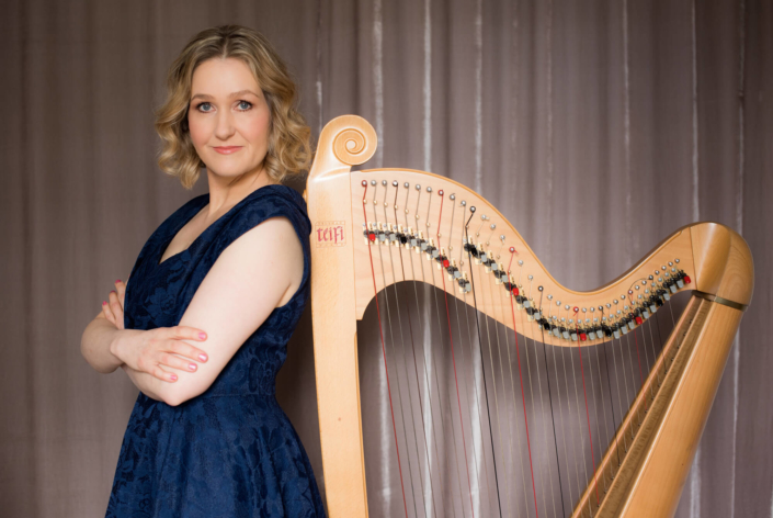 Bethan Nia posing with her harp