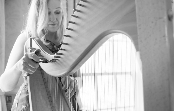Black and white harp photograph with Bethan Nia